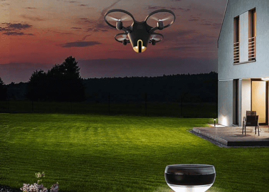 Security drone patrolling a house